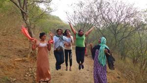 Sahodari girls jumping in joy during a morning walk in Anaikatti hills