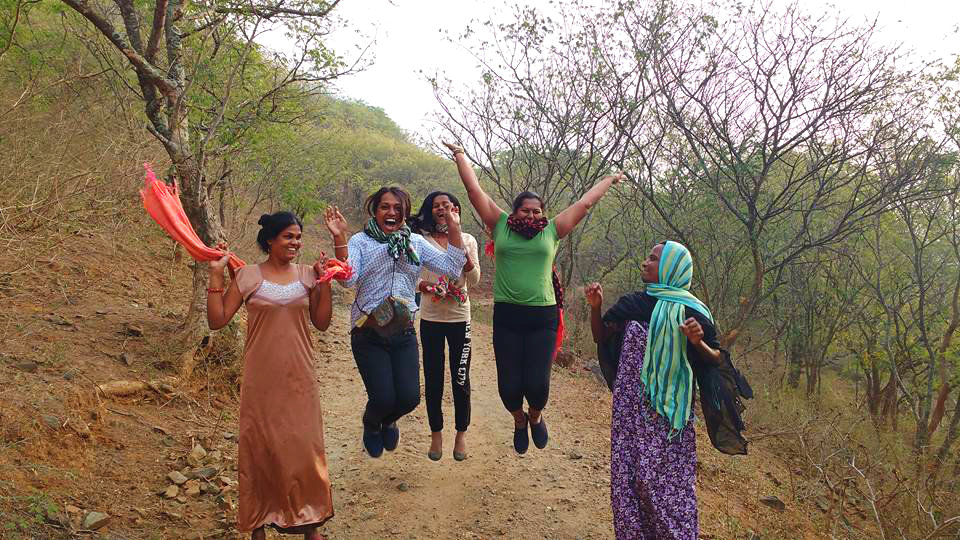 Sahodari girls jumping in joy during a morning walk in Anaikatti hills