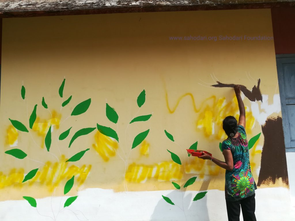 Transwoman Sandhiya paints school walls - Sahadari Foundation