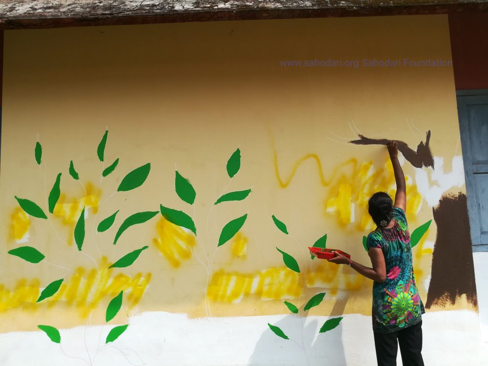 Transwoman Sandhiya paints school walls - Sahadari Foundation